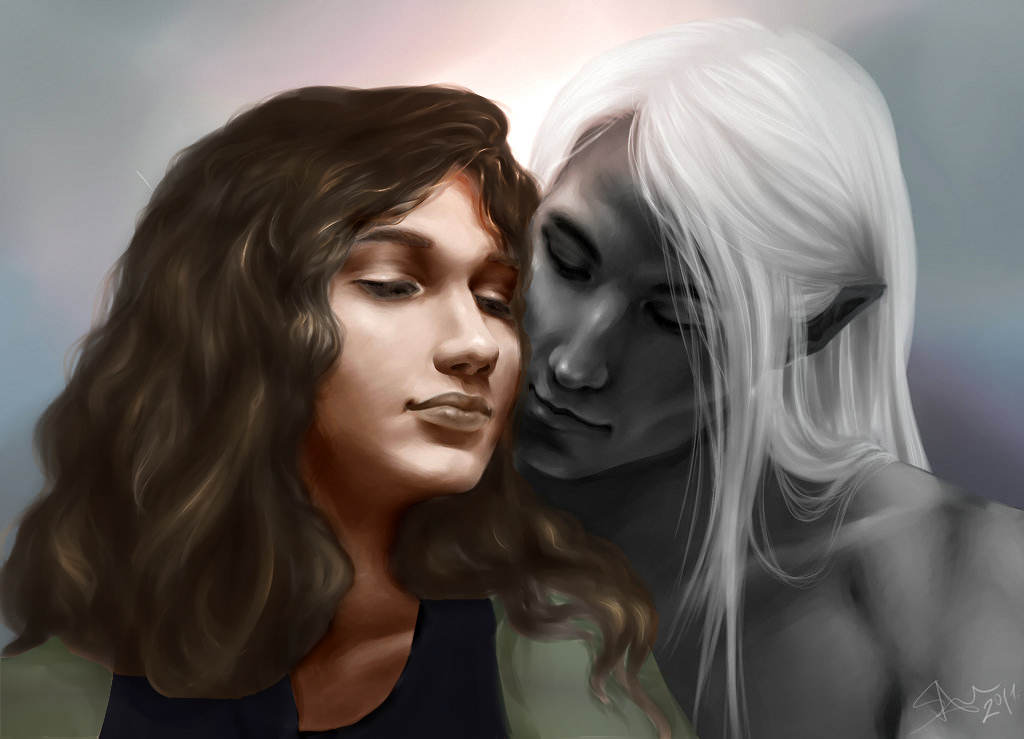 Human female and white haired elf embrace