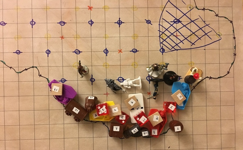 Battle map with numbered items and minis