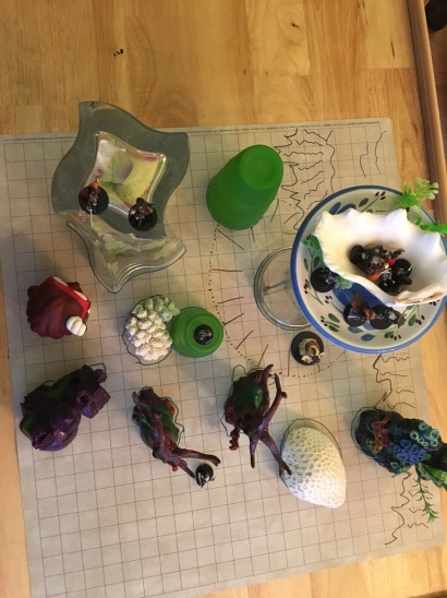 D&D minis set up on a battlemap