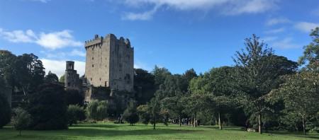 Blarney Castle on a day with blue skys and whisps of clouds