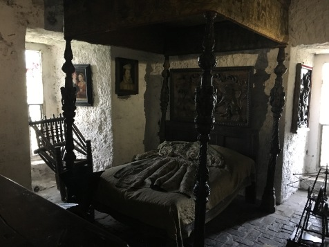 lareg 4-poster canopy bed inside Bunratty