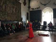lady in red dress talking to tourist in the great room