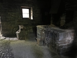 A blacksmith's forge and other tools