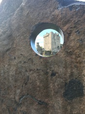 Blarney Castle framed through circle in stone