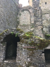 arched opening leading to cave/dungeon
