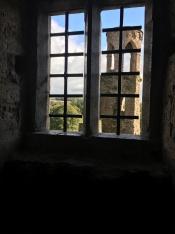bell tower through window of Blarney Castle